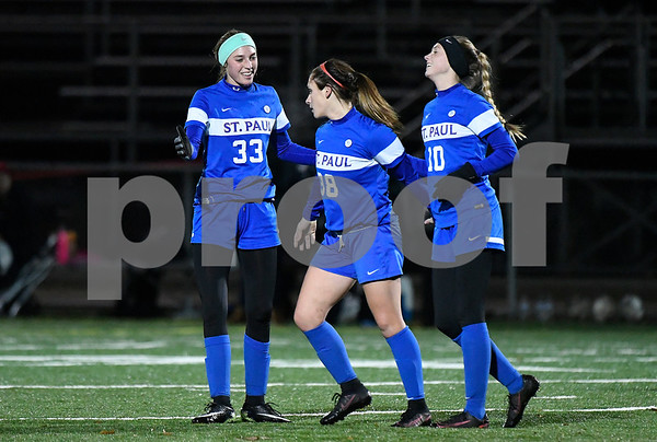 11/14/2017 Mike Orazzi | Staff St. Paul's Briana Senese (38) celebrates her goal with teammates Addison Davis (33) and Kendall Davis (10) against Old Lyme during the Class S Semifinals Girls Soccer at Falcon Field in Meriden Tuesday night.