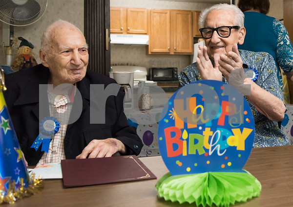 11/14/17 Wesley Bunnell | Staff Birthday boys Leon Hatoff, age 104, and Jerry DeVito, age 100, celebrated their birthdays on Tuesday afternoon at Franklin Square Manor.