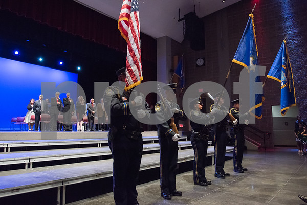 11/14/17 Wesley Bunnell | Staff The inauguration of Mayor Erin E. Stewart and other elected officials was held on Tuesday morning at New Britain High School. The New Britain Police Department Honor Guard stands at the front of the stage.