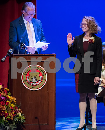 11/14/17 Wesley Bunnell | Staff The inauguration of Mayor Erin E. Stewart and other elected officials was held on Tuesday morning at New Britain High School. Town and City Clerk Mark H. Bernacki swears in Tax Collector Cheryl S. Blogoslawski.