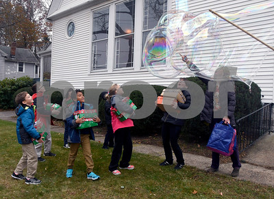 11/14/2017 Mike Orazzi   Staff Giant bubbles make by Pastor Bryce Whiting at the Calvary Advent Church in Bristol Tuesday afternoon. The pastor treated children from the Immanuel Lutheran School to bubbles as they dropped off boxes of donated items for Operation Christmas Child.