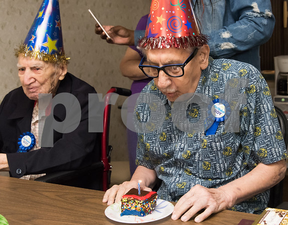 11/14/17 Wesley Bunnell | Staff Birthday boys Leon Hatoff, age 104, and Jerry DeVito, age 100, celebrated their birthdays on Tuesday afternoon at Franklin Square Manor. DeVito blows out the candle while sitting next to Hatoff.