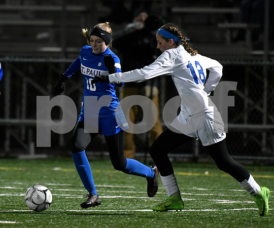 11/14/2017 Mike Orazzi | Staff St. Paul's Kendall Davis (10) and Old Lyme's Caroline Wallace (18) during the Class S Semifinals Girls Soccer at Falcon Field in Meriden Tuesday night.