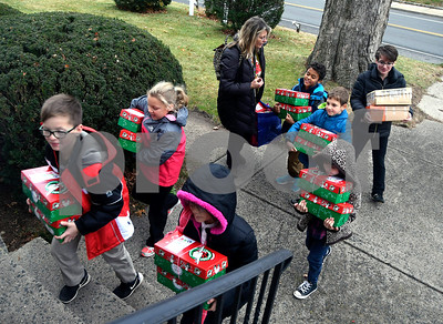 11/14/2017 Mike Orazzi   Staff Immanuel Lutheran School students as they drop off boxes of donated items for Operation Christmas Child at the Calvary Advent Church in Bristol Tuesday afternoon.