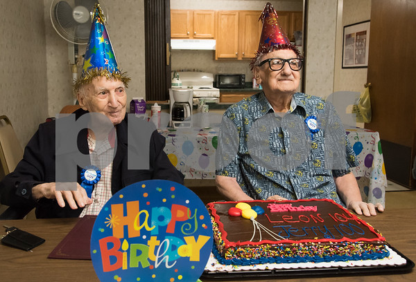 11/14/17 Wesley Bunnell | Staff Birthday boys Leon Hatoff, age 104, and Jerry DeVito, age 100, pose for a photo as they celebrate their birthdays on Tuesday afternoon at Franklin Square Manor.