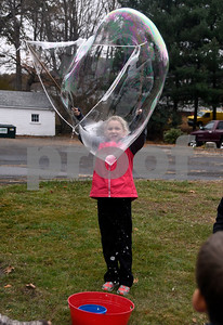 11/14/2017 Mike Orazzi   Staff Immanuel Lutheran School's Elizabeth Hathaway makes a giant bubble after dropping off boxes of donated items for Operation Christmas Child at the Calvary Advent Church in Bristol Tuesday afternoon.