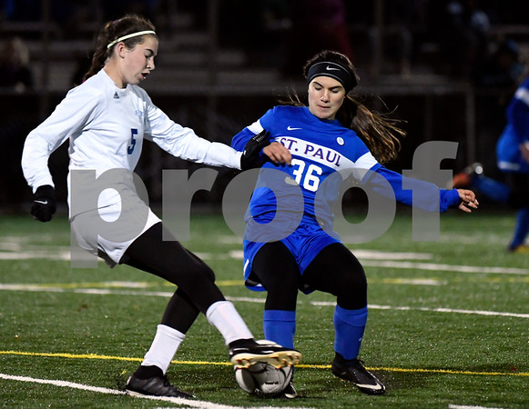 11/14/2017 Mike Orazzi | Staff St. Paul's Isabella Griffin (36) and Old Lyme's Emily DeRoehn (5) during the Class S Semifinals Girls Soccer at Falcon Field in Meriden Tuesday night.