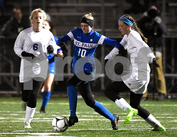 11/14/2017 Mike Orazzi | Staff St. Paul's Kendall Davis (10) and Old Lyme's Ellery Zrenda (6) and Caroline Wallace (18) during the Class S Semifinals Girls Soccer at Falcon Field in Meriden Tuesday night.