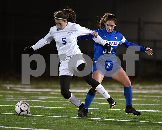 11/14/2017 Mike Orazzi | Staff St. Paul's Briana Senese (38) and Old Lyme's Emily DeRoehn (5) during the Class S Semifinals Girls Soccer at Falcon Field in Meriden Tuesday night.