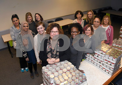 11/16/2017 Mike Orazzi | Staff Staff from the Bristol Hospital WIC Program on Prospect Street Thursday morning. Staff assembled Thanksgiving food packages for local families courtesy of donations from the Bristol Hospital Medical Staff.