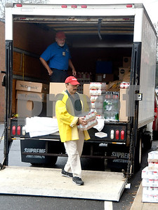 11/16/2017 Mike Orazzi | Staff Bristol Hospital's Lou Therrien and Mike Jarry while unloading food for area needy at the Bristol Hospital WIC Program on Prospect Street Thursday morning. Staff assembled Thanksgiving food packages for local families courtesy of donations from the Bristol Hospital Medical Staff.