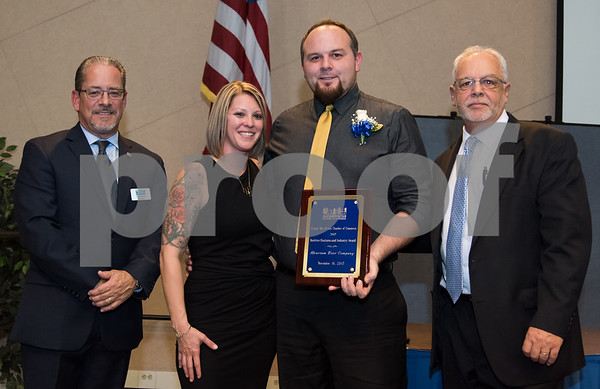 11/16/17 Wesley Bunnell | Staff The Greater New Britain Chamber of Commerce covering New Britain and Berlin held their annual dinner Thursday evening at CCSU celebrating 104 years. President Tim Stewart stands next to Kate & Mike Larson who accepted the Beehive Business & Industry Award for Alvarium Beer Company with Economic Development Director Bill Carroll to the R.