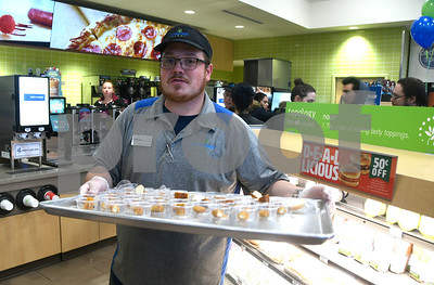 11/16/2017 Mike Orazzi | Staff Cumberland Farms employee David Kennan serves snacks during the grand opening of  the new Cumberland Farms location on Pine Street at the intersection of Emmett Street Thursday.
