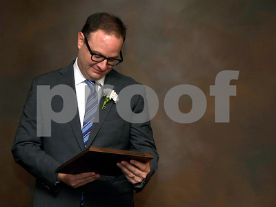 11/17/2017 Mike Orazzi | Staff The 2017 Bristol Sports Hall of Fame Inductee Adrian Wojnarowski looks over his plaque during The 2017 Bristol Sports Hall of Fame dinner at the DoubleTree by Hilton Hotel in Bristol Friday evening.