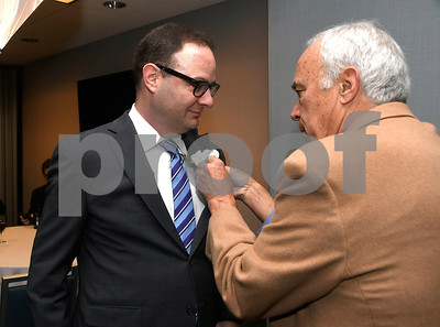 11/17/2017 Mike Orazzi | Staff The 2017 Bristol Sports Hall of Fame Inductee Adrian Wojnarowski has a corsage pinned on him by John Benoit during The 2017 Bristol Sports Hall of Fame dinner at the DoubleTree by Hilton Hotel in Bristol Friday evening.