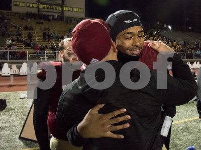 11/17/17  Wesley Bunnell | Staff  New Britain football defeated Berlin in its last game to finish 5-5 on the season at Veterans Stadium on Friday evening.  Senior Jahfari Newman (2) gets a hug from an assistant coach after the game.