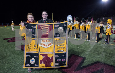 11/17/17  Wesley Bunnell | Staff  The New Britain High School Golden Hurricane Marching Band payed tribute to the late Band Director David Kayser before the start of the game vs Berlin on Friday night. David's widow Martha Kayser stands with current Band Director Justin Carlin behind a quilt which was presented to her made up of marching band uniforms.
