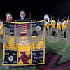 11/17/17  Wesley Bunnell | Staff<br /> <br /> The New Britain High School Golden Hurricane Marching Band payed tribute to the late Band Director David Kayser before the start of the game vs Berlin on Friday night. David's widow Martha Kayser stands with current Band Director Justin Carlin behind a quilt which was presented to her made up of marching band uniforms.