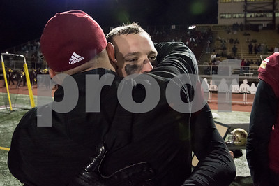 11/17/17  Wesley Bunnell | Staff  New Britain football defeated Berlin in its last game to finish 5-5 on the season at Veterans Stadium on Friday evening.  Senior Jacob Clark (54) gets a hug from an assistant coach after the game.