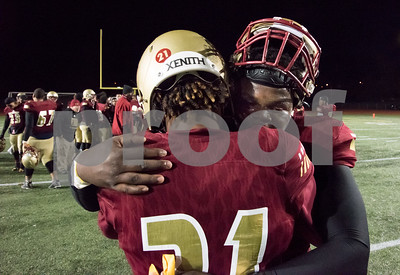 11/17/17  Wesley Bunnell | Staff  New Britain football defeated Berlin in its last game to finish 5-5 on the season at Veterans Stadium on Friday evening. Tyree Pinnock (56) facing camera hugs Senior Cartagena Jensen (21).
