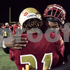 11/17/17  Wesley Bunnell | Staff<br /> <br /> New Britain football defeated Berlin in its last game to finish 5-5 on the season at Veterans Stadium on Friday evening. Tyree Pinnock (56) facing camera hugs Senior Cartagena Jensen (21).