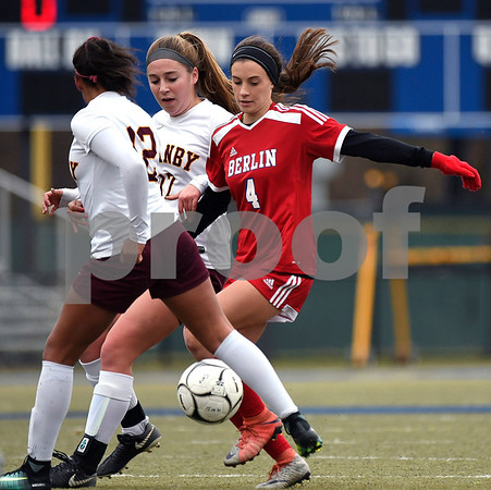11/18/2017 Mike Orazzi | Staff Granby Memorial's Samantha St. Pierre (12) and Berlin's Maxine Muscatello (4) during the Class M Final at Municipal Stadium in Waterbury Saturday. Granby won 3-0.