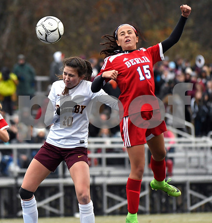 11/18/2017 Mike Orazzi | Staff Granby Memorial's Sydnie Dorman (10) and Berlin's Cameron Michalek (15) during the Class M Final at Municipal Stadium in Waterbury Saturday. Granby won 3-0.
