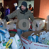 11/20/17  Wesley Bunnell | Staff<br /> <br /> HRA held its annual turkey distribution at the New Britain Food & Resource Center on Monday afternoon with help from workers and volunteers. HRA employee and food drive volunteer Travis Nichols sorts through turkey's ready for distribution.