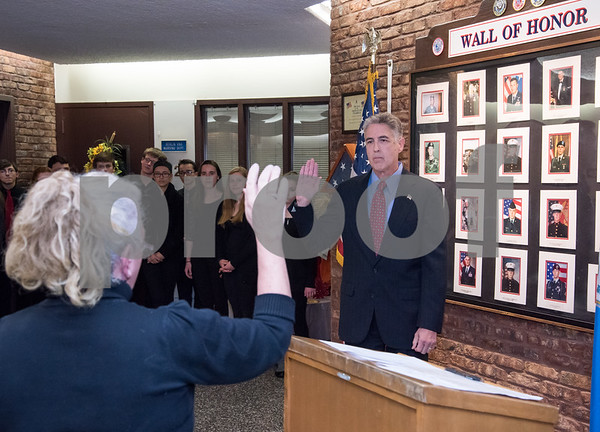 11/21/17 Wesley Bunnell | Staff Berlin held their Swearing-In Ceremony for elected officials at Berlin Town Hall on Tuesday evening. Mayor Mark Kaczynski is sworn in by Town Clerk Kate Wall.