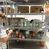 11/21/17  Wesley Bunnell | Staff<br /> <br /> The New Britain Salvation Army has seen a 100 percent increase in families looking for assistance from the food pantry since August in part due to the hurricanes. Food pantry volunteer Mirta Soto sorts through cans of food.