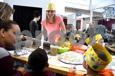11/21/2017 Mike Orazzi | Staff Pre-school teacher Kriste Brady during the annual Day of Thanks Luncheon at Imagine Nation Museum Tuesday morning. Members and families from our Early Learning School will come together for a Thanksgiving meal and to create leaves in the Art Studio for our Thankful Tree.