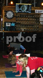 Photo by Erica Schmitt | Staff Stretching out the kinks of the workweek at Alvarium Beer Company Sunday morning, people take part in one of the popular yoga classes held at the brewery. (The Bristol Press-Erica Schmitt).