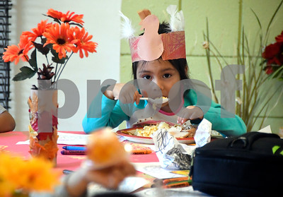 11/21/2017 Mike Orazzi | Staff Katie Xelhua eats a Thanksgiving Day meal during the annual Day of Thanks Luncheon at Imagine Nation Museum Tuesday morning. Members and families from our Early Learning School will come together for a Thanksgiving meal and to create leaves in the Art Studio for our Thankful Tree.