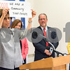 11/21/17  Wesley Bunnell   Staff<br /> <br /> A conference was held Tuesday morning at New Britain City Hall between the city and The United Way announcing a program where city employees can elect to have a portion of their paycheck automatically donated to The United Way.  President and CEO of The United Way of Central and Northeastern CT Paula Gilberto who was unable to speak due to illness held up messages for the audience expressing her feelings.  Chamber of Commerce Chairperson Robin Sharp, President Tim Stewart and Superintendent of Schools Nancy Sarra look on.