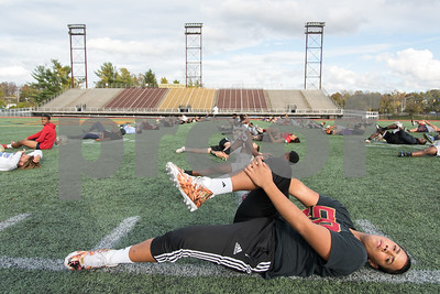 11/2/17  Wesley Bunnell | Staff  New Britain high school football held a walk through practice without pads on Thursday afternoon at Veterans' Stadium.  Brandon Rivera (50) stretches with the team.