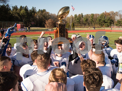 11/23/17  Wesley Bunnell | Staff  Southington football topped Cheshire on Thanksgiving morning in the Apple Valley Classic at Cheshire High School.  Players celebrate with the Apple Valley Classic Trophy.