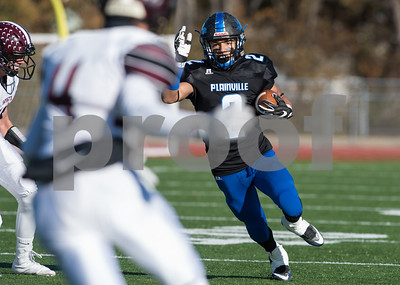11/23/17  Wesley Bunnell | Staff  Plainville football was defeated by Farmington on Thanksgiving morning for The Olde Canal Cup. Ej Wynkoop (2) looks downfield for running room.