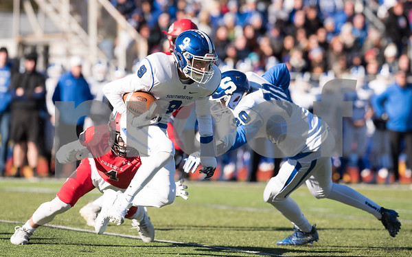 11/23/17 Wesley Bunnell | Staff Southington football topped Cheshire on Thanksgiving morning in the Apple Valley Classic at Cheshire High School. WR Will Downes (9) runs for yards after the catch.