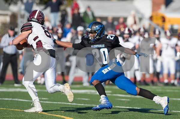 11/23/17 Wesley Bunnell | Staff Plainville football was defeated by Farmington on Thanksgiving morning for The Olde Canal Cup. Alex Hernandez (20) reaches for the Farmington QB.