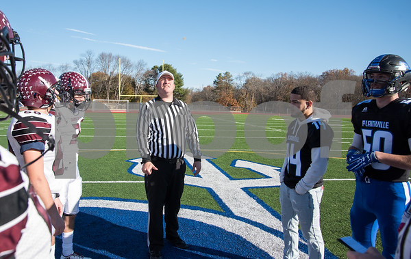 11/23/17 Wesley Bunnell | Staff Plainville football was defeated by Farmington on Thanksgiving morning for The Olde Canal Cup. The referee tosses the coin in the air as Angel Wren (14) and Nick Cianchetti (50) watch.