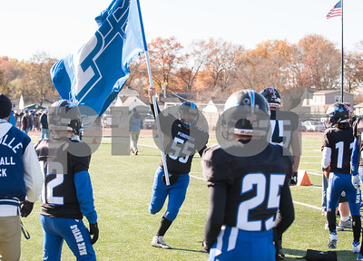 11/23/17  Wesley Bunnell | Staff  Plainville football was defeated by Farmington on Thanksgiving morning for The Olde Canal Cup. Justin Ciotto (55) runs with the Plainville flag across the sideline.