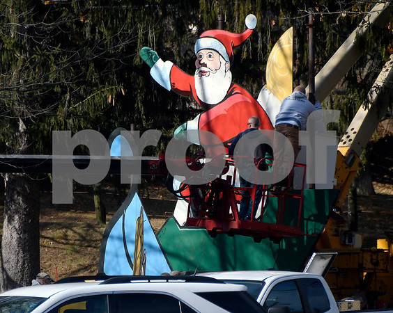 11/25/2017 Mike Orazzi | Staff Santa gets installed in Terryville's Baldwin Park Saturday morning.