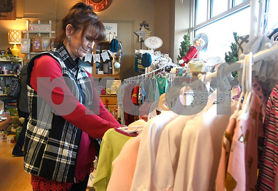 11/25/2017 Mike Orazzi | Staff Deb Curtis of Southington while shopping at Good Cause Gifts on Main Street in Berlin Saturday.
