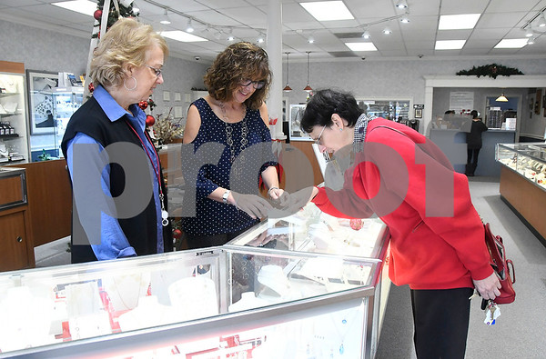11/25/2017 Mike Orazzi | Staff Diana Diliberto (right) while shopping at Shannon's Diamonds & Fine Jewelry with help from Nancy Curley and Kim Baigert in Bristol Shop Small Saturday.