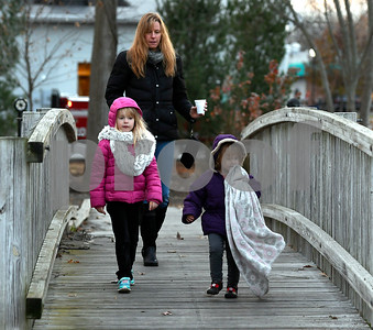 11/25/2017 Mike Orazzi | Staff Melissa Matteson and her daughters Alivia, 2 1/2, and Ava,5, arrive for the Town of Berlin Fire Department's annual tree lighting at the Veteran's Memorial Park Saturday evening.