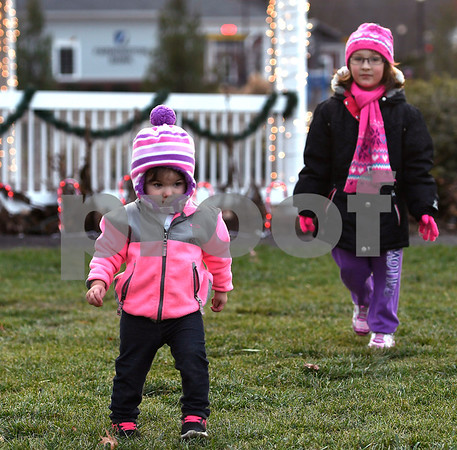 11/25/2017 Mike Orazzi | Staff Rylee D'Aleo, 1 1/2, and her cousin Katalana LaVallee, 5, during the Town of Berlin Fire Department's annual tree lighting at the Veterans Memorial Park Saturday evening.