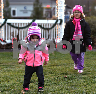 11/25/2017 Mike Orazzi | Staff Rylee D'Aleo, 1 1/2, and her cousin Katalana LaVallee, 5, during the Town of Berlin Fire Department's annual tree lighting at the Veteran's Memorial Park Saturday evening.