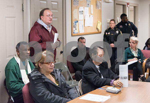 11/27/17 Wesley Bunnell | Staff State Attorney Brian Preleski, L standing, spoke to the North Oak NRZ on Monday evening at the police substation answering questions about the duties of his office and how it affects them.
