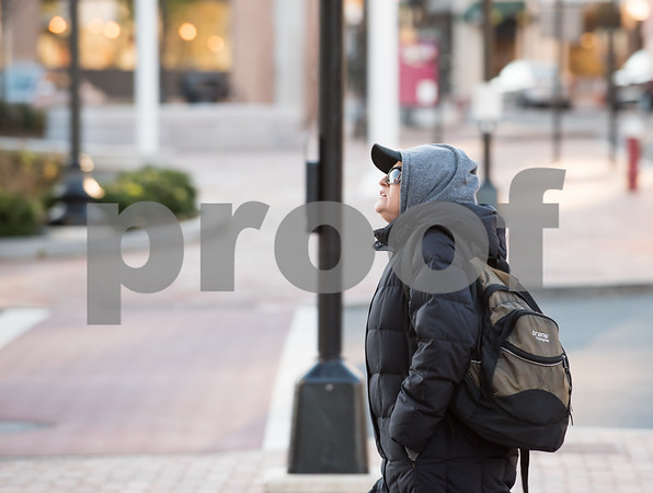 11/27/17 Wesley Bunnell | Staff The cold weather forced pedestrians to bundle up walking through downtown New Britain on Monday afternoon on Main St.