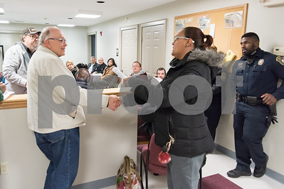 11/27/17   Wesley Bunnell | Staff  Alderman Don Naples shakes hands with a concerned area resident who only gave her first name as Anette at the North Oak NRZ meeting on Monday evening before State Attorney Brian Preleski spoke to the NRZ regarding the duties of his office.